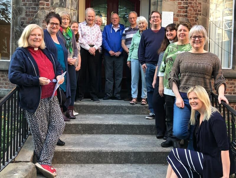 members of the PCC pose on the steps of No6, one of the parish's buildings on the Emmanuel site