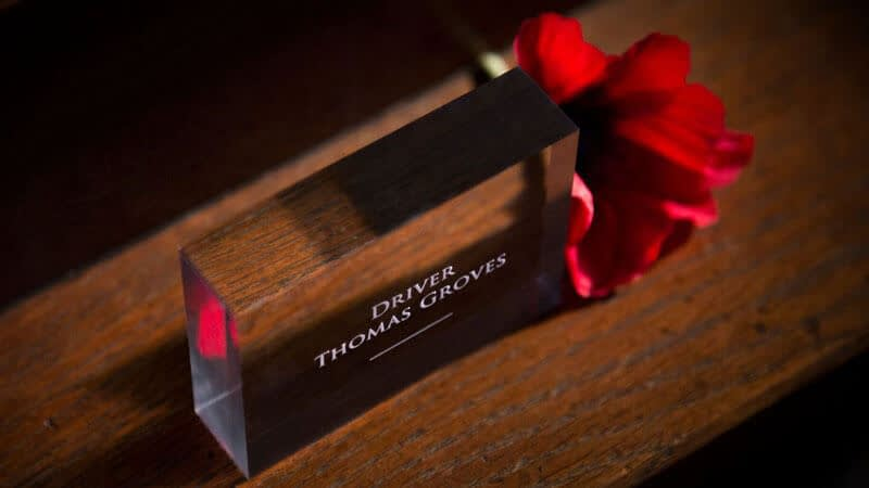 Small acrylic block with a soldier's name engraved and a red poppy alongside