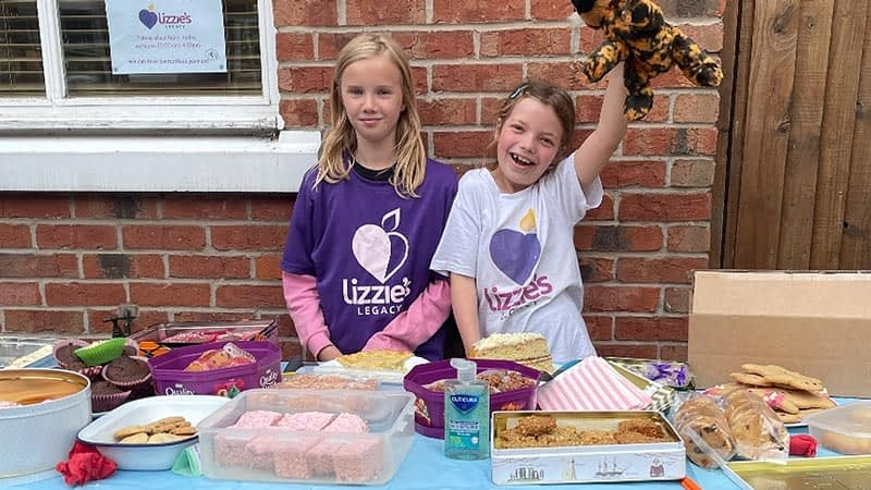Daisy and her cousin at the cake stall