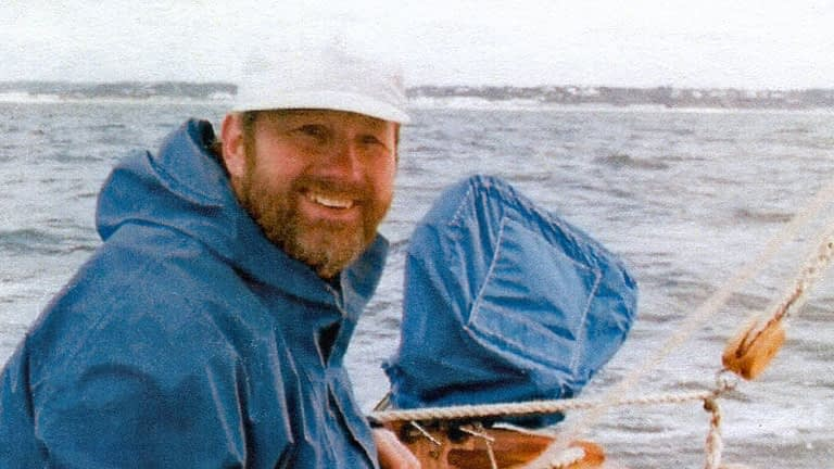John sailing, with a big smile on his face