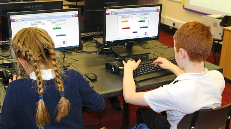 A girl and boy working in the ICT suite