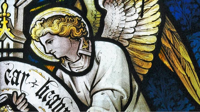 Detail of an angel from a stained galss window in St James church