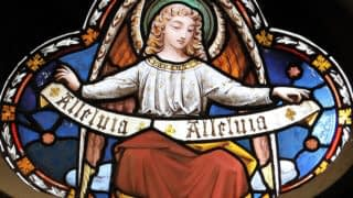 Emmanuel stained glass depicting an angel holding a scroll saying 'Allelulia'