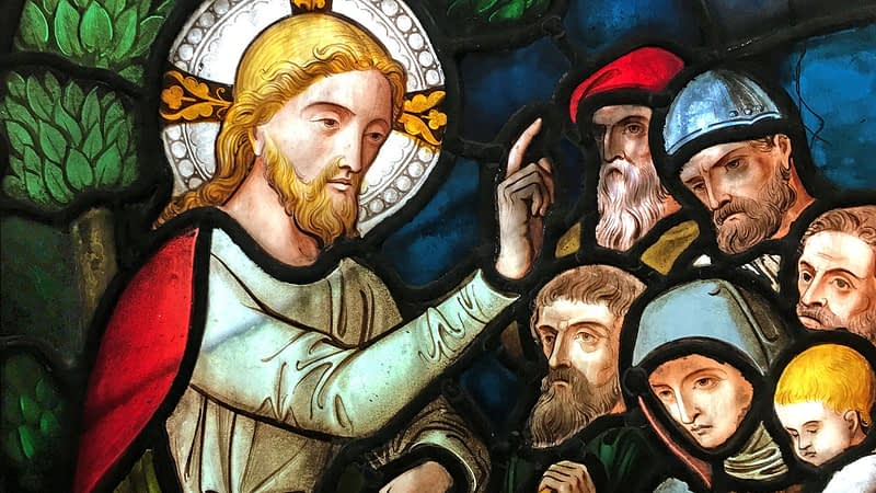 Detail of St James church stained glass window showing Jesus preaching
