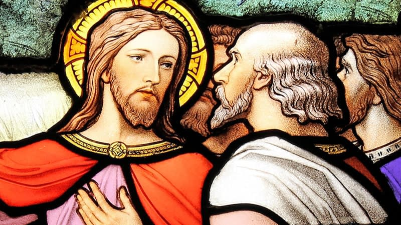 Emmanuel stained glass depicting Jesus talking to two of his disciples