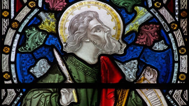 Detail of a stained glass window in Emmanuel depicting a bearded man with a halo