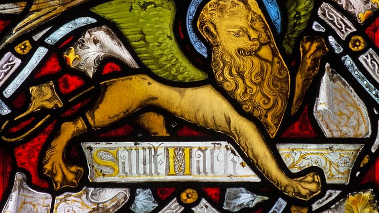 Detail of a stained glass window in Emmanuel depicting a lion – the symbol for St Mark