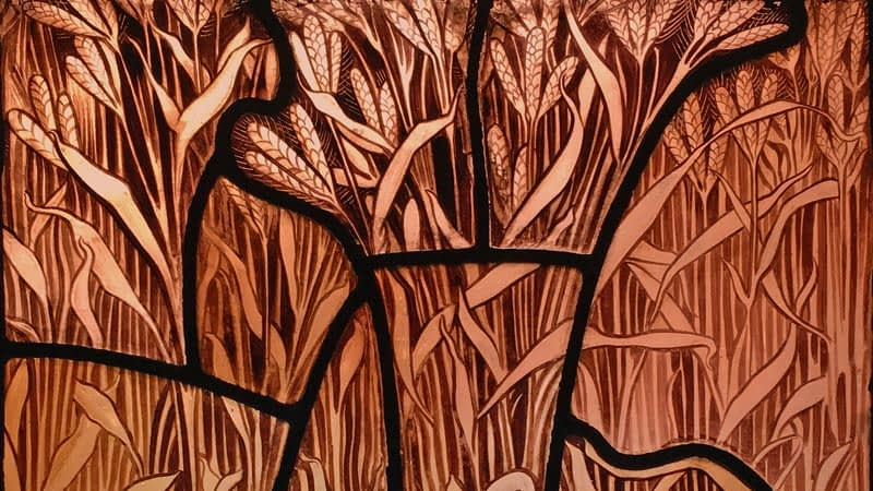 Detail of a stained glass window in Emmanuel depicting a field of wheat