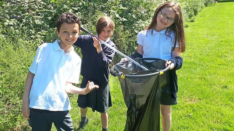 Pupils collecting litter near the school