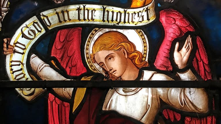 Detail of St James church stained glass window showing an angel