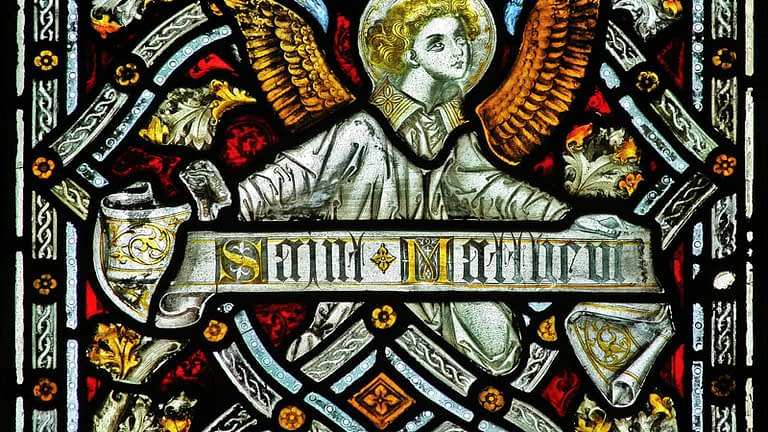 Stained glass detail depicting St Matthew