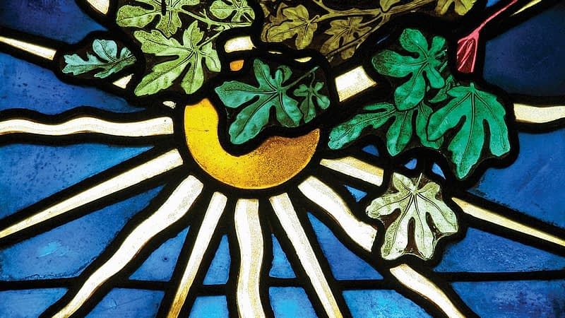 Detail of stained glass window from Emmanuel depicting a rising sun