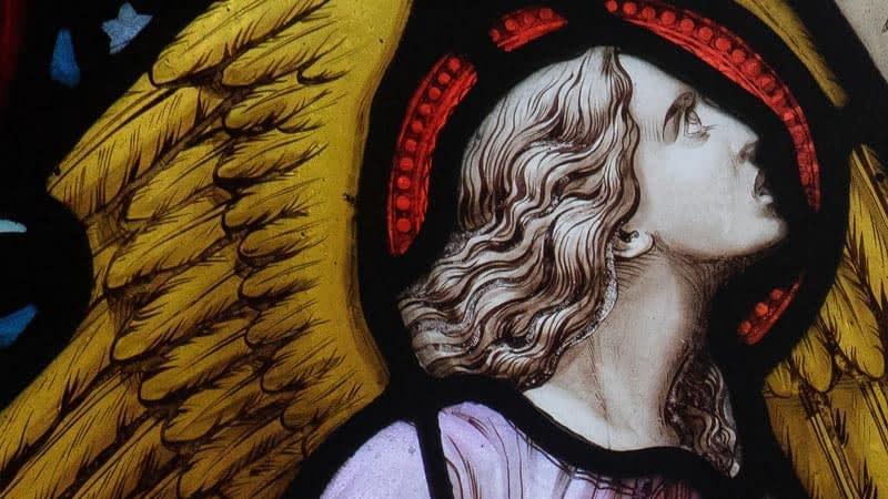 Detail of a stained glass window in Emmanuel depicting an angel