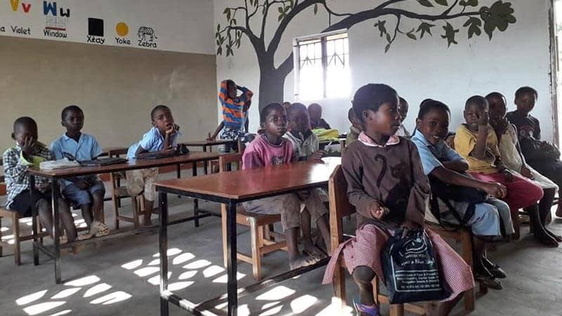 Children sitting in a dry classroom