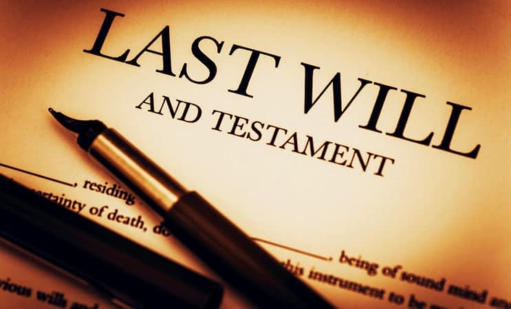 A fountain pen laced on the first page of a will, with