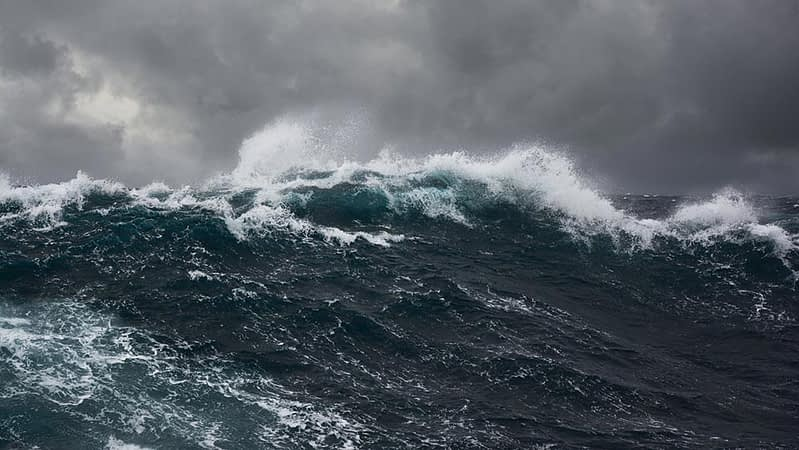 A dark rough sea with foaming waves
