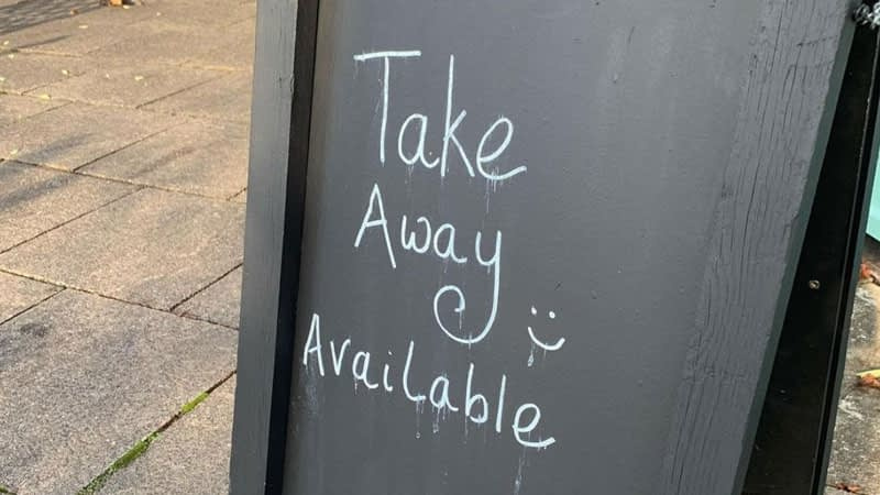 Chalkboard stating 'takeaway available'