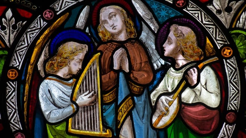 Detail of a stained glass window in Emmanuel depicting three musicians