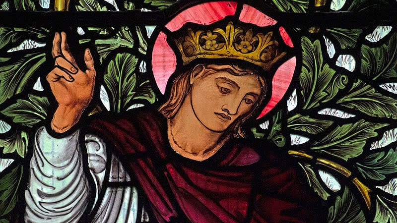 Detail of a stained glass window in Emmanuel depicting Christ in the William Morris window