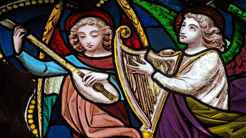 Detail of a stained glass window in Emmanuel depicting angels playing harps