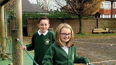 Two pupils wearing the new St Elisabeth's CE uniform