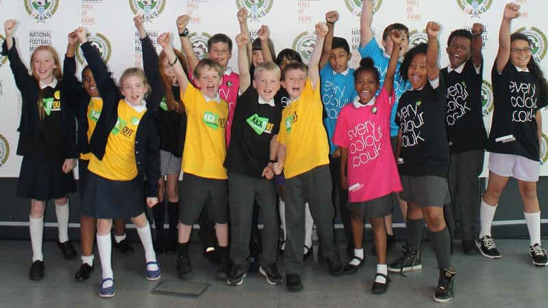 Cheering pupils wearing Kick It Out and Everycolour t-shirts enjoy the quiz at the National Football Museum
