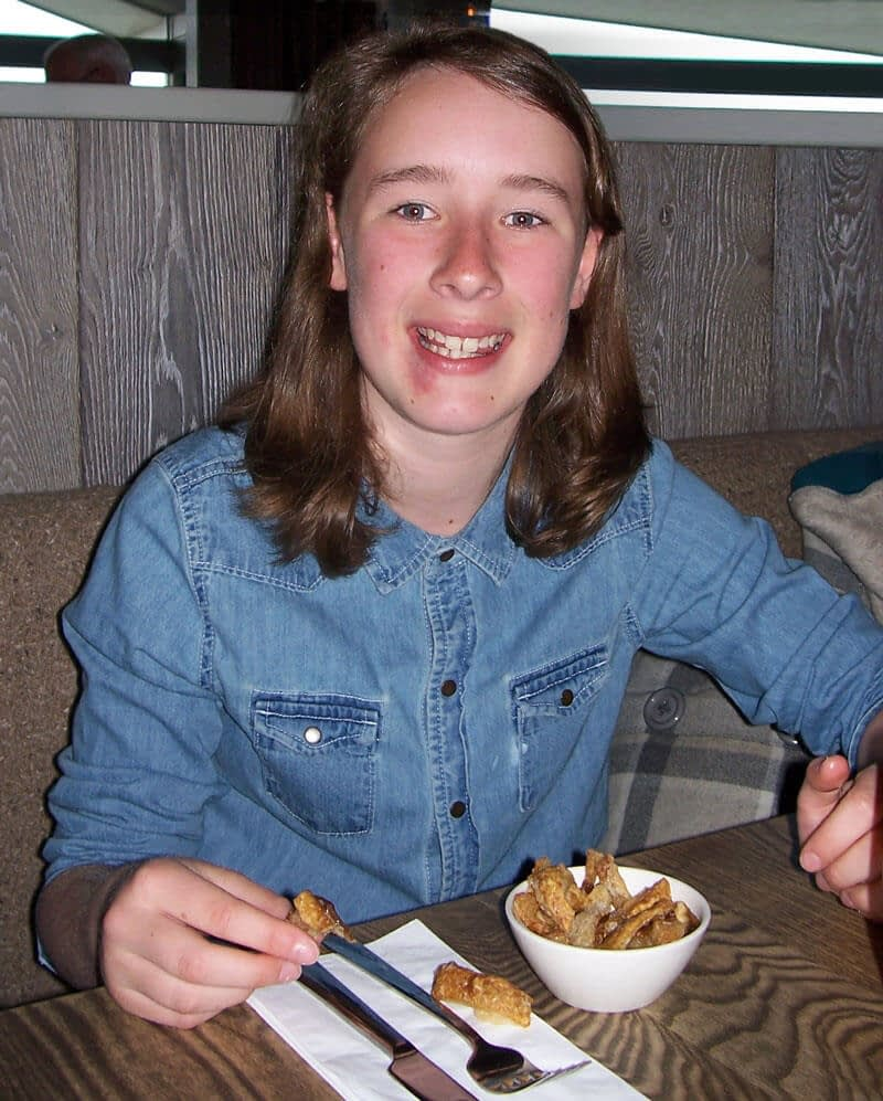 A smiling Lizzie prepares to tuck into her chips